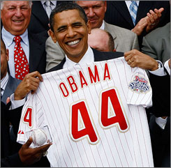 President Obama, shown with a jersey given to him by the World Series champion Philadelphia Phillies, will become the first sitting U.S. president to throw a ceremonial first pitch at the All-Star Game since Gerald Ford in 1976.
