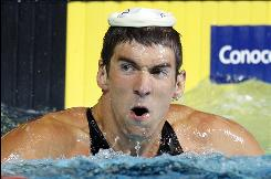 United States swimmer Michael Phelps looks to the stands after setting a new world record in the men's 100-meter butterfly at the USA Swimming National Championships in Indianapolis on July 9.