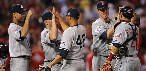 American League All-Stars, from left, Derek Jeter, Kevin Youkilis, Mariano Rivera, Joe Nathan and Victor Martinez celebrate after they knocked off the National League 4-3 in the 80th All-Star Game at Busch Stadium. The AL improved to 12-0-1 against the NL in the last 13 All-Star contests.