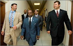 NFLPA chief DeMaurice Smith, center, led a cadre of players, including Chiefs LB Mike Vrabel, left, and Browns LT Joe Thomas, right, into the halls of Congress on Wednesday.