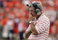 Former Clemson football coach Tommy Bowden, reacting after a play was called back during a game on Sept. 27, 2008, thought he would be able to right the Tigers' ship last season before stepping down six games into the season.