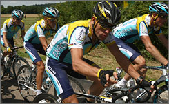 Lance Armstrong rides with his Astana teammates during Stage 12. Armstrong suffered a flat tire in the final third of the stage but made it easily back into the main pack.