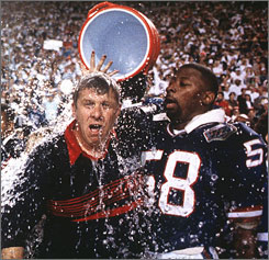 New York Giants linebacker Carl Banks douses coach Bill Parcells with Gatorade after beating the Buffalo Bills 20-19 to win the Super Bowl in 1991. The Giants started the Gatorade shower tradition in 1985.