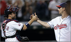 Catcher Kelly Shoppach congratulates pitcher Cliff Lee on his complete game after the Indians beat the Mariners 4-1.