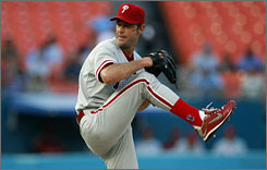 Jamie Moyer allowed one hit in seven innings to improve his career record against the Marlins to 13-2.