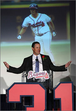 Former Braves pitcher Greg Maddux gives his acceptance speech as he is inducted into the Braves Hall and has his No. 31 retired. Maddux won three of his four Cy Young awards during his 11 seasons with Atlanta.