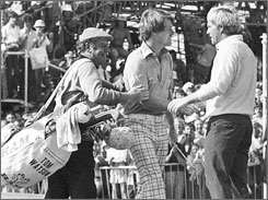 In this July 9, 1977 file photo, Jack Nicklaus, right, congratulates fellow American Tom Watson, who beat Nicklaus to win the British Open at Turnberry, Scotland. At left is Watson's caddie Alf Fyles.