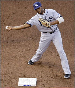 Rays second baseman Willy Aybar throws over the head of the Royals' Mark Teahen to complete the double play during the second inning.