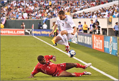 Team USA's Heath Pearce jumps over Panama's Luis Moreno during a CONCACAF Gold Cup quarterfinal match at Lincoln Financial Field in Philadelphia.