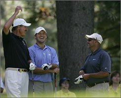 From left, former baseball player Rick Rhoden, Dallas Cowboys quarterback Tony Romo, and Hall of Fame hockey goalie Grant Fuhr joke before teeing off on the 12th during the American Century Golf Championship.