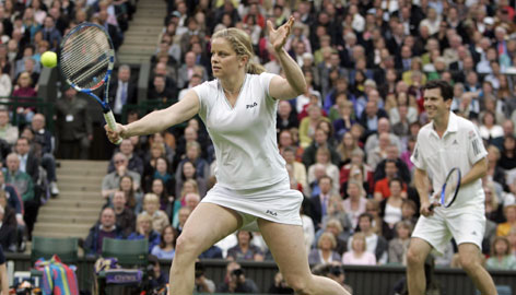 Kim Clijsters, left, played mixed doubles with former British tennis star Tim Henman in an exhibition match against Steffi Graf and Andre Agassi at Wimbledon earlier this year. The event awakened Clijsters' desire to compete again.