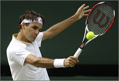 Roger Federer plays a backhand during his win in the Wimbledon final, restoring his No. 1 ranking. He had held No. 1 for 237 weeks before losing it to Rafael Nadal.