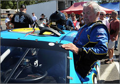 Hershel McGriff climbs into his car before qualifying at Portland International Raceway.