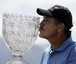 Rick Rhoden kisses the trophy after winning the American Century Celebrity Golf Championship at Edgewood Tahoe Golf Course in Stateline, Nev.
