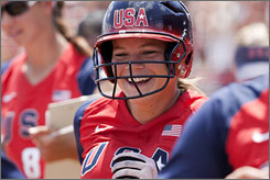 Ashley Hansen smiles as she returns to the dugout after swatting a third-inning grand slam against Australia.