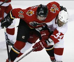 Former 30-goal scorer Alex Tanguay, left, and Todd Bertuzzi, a former 46-goal scorer, battle during a game in Calgary in 2007. Both remain available.