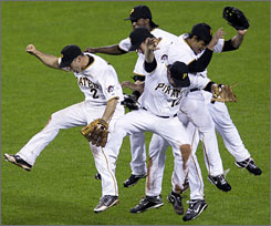 The Pittsburgh Pirates celebrate after beating the Brewers 8-5. The win snapped a 17-game losing streak to Milwaukee.