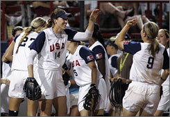 Team USA starting pitcher Monica Abbott (14) high-fives teammate Kaitlin Cochran, right, in the top half of the fifth inning.
