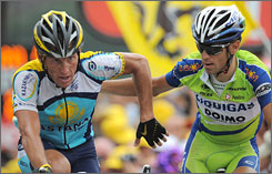 Lance Armstrong and Vincenzo Nibali congratulate each other as they cross the finish line of Stage 17 in fourth and fifth place.