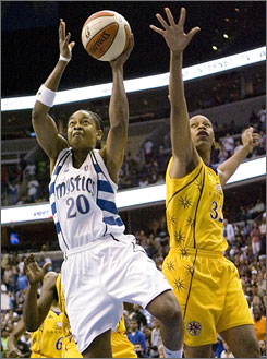 The Mystics' Alana Beard, shooting over the Sparks' Tina Thompson on July 11, was voted an All-Star starter for the first time.