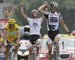 Frank Schleck, right, won the 17th stage while Alberto Contador, left, was second.