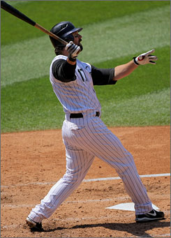 Todd Helton became the 50th player to hit 500 doubles, driving one off the right-field scoreboard in the third inning of Colorado's game Wednesday against Arizona.