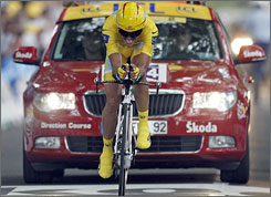 Alberto Contador pushes toward the finish line to win the Tour de France's 18th stage.