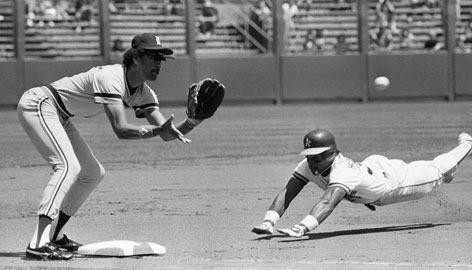 In 1982, the Athletics' Rickey Henderson becomes airborne taking third as the Tigers' Enos Cabell awaits the throw. He had 130 steals that year, a record that may never be threatened.