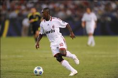 AC Milan midfielder Clarence Seedorf dribbles the ball in the first half of the World Football Challenge against Chelsea at M&T Bank Stadium in Baltimore. Chelsea won the game 2-1 behind Yuri Zhirkov's tiebreaking goal in the 69th minute.