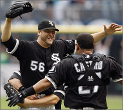 White Sox pitcher Mark Buehrle embraces catcher Ramon Castro after throwing his perfect game against the Rays on Thursday.