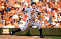San Francisco Giants starting pitcher Matt Cain became the second 12-game winner in Major League Baseball, scattering three hits over seven innings to help the Giants beat the Colorado Rockies 3-1 at Coors Field. 