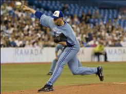 Toronto Blue Jays starting pitcher Roy Halladay works against the Tampa Bay Rays during the first inning in Toronto. In what could be his final game in a Blue Jays uniform, Halladay hurled nine innings as the Rays won 4-2.