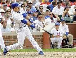 The Chicago Cubs' Aramis Ramirez breaks a 3-3 tie with a home run off Cincinnati Reds starting pitcher Aaron Harang during the sixth inning at Wrigley Field in Chicago. Ramirez drove in three runs, leading the Cubs to an 8-5 win.
