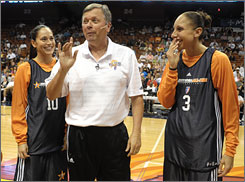 The Seattle Storm's Sue Bird, left, and the Phoenix Mercury's Diana Taurasi, right, share a laugh with San Antonio head coach Dan Hughes during a practice session for the Western Conference All-Stars. The WNBA All-Star game is Saturday in Connecticut.