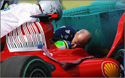 Medics and track marshals attend to Felipe Massa after his Ferrari smashed into a tire barrier at Hungaroring.