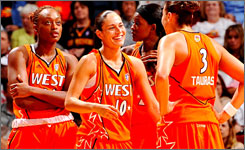 Charde Houston, left, looks on as West teammates Sue Bird (10) and Diana Taurasi share a laugh during the All-Star Game.