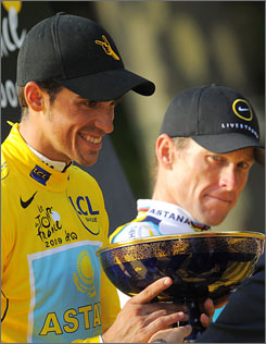 """Cycling commentator Phil Liggett called seven-time Tour de France champion Lance Armstrong's comeback """"one of the most incredible returns by any sportsman to the top of his game."""" Armstrong, right, finished in third place to Alberto Contador in this year's race."""