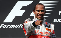 Lewis Hamilton celebrates after winning the Hungarian Grand Prix for his first victory of the 2009 season.