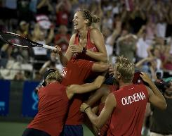 The Washington Kastles celebrate their victory against the Springfield Lasters in the World TeamTennis final on Sunday in Washington.