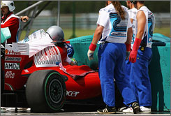 Workers assist in getting Felipe Massa out of his car following a crash during qualifying for the Hungarian Grand Prix. Massa remained in &quot;life-threatening&quot; but stable condition on Sunday.