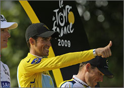 Tour de France winner Alberto Contador of Spain, wearing the overall leader's yellow jersey, gives the thumbs up at the podium.