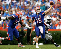 Tim Tebow takes aim at his second Heisman Trophy and his third national title with the Florida Gators this season.