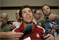 "Sam Bradford, answering questions during the Big 12 Conference's annual football preview, said autographing a couple's infant baby ""was strange."""