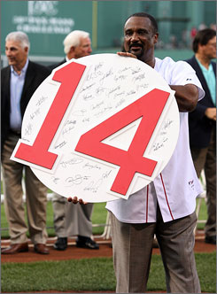 Former Red Sox outfielder Jim Rice shows off his retired number plaque during a ceremony before Boston's game against the Oakland Athletics Tuesday at Fenway Park.