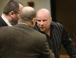 With his attorney Legrand Jones at his side, mixed martial artist Jeff Monson, right, speaks to Thurston County Deputy Prosecutor Joe Wheeler after his arraignment in Superior Court in Olympia, Wash. on Jan. 27.