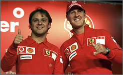 Then-Ferrari teammates Michael Schumacher, right, and Felipe Massa give a thumbs-up before Schumacher's most recent F1 race, the 2006 Brazilian Grand Prix.