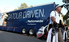 Golfer J.L. Lewis walks past the The Truck, the Nationwide Tour's operational hub and home away from home, in Mitchellville, Md., on June 6. Golfers appreciate the community spirit The Truck helps bring to the tour.