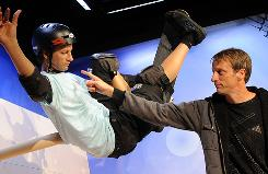 Extreme sports legend Tony Hawk points at his wax figure at the figure's unveiling Wednesday at Madame Tussauds in Hollywood.
