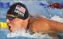 Ryan Lochte swims the butterfly leg en route to setting a world record in the 200-meter individual medley final at the world championships on Thursday.