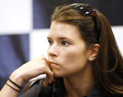 IndyCar Racing League driver Danica Patrick, shown at a news conference at the Kentucky Speedway on Thursday, is not racing to decide where she will drive in the future, even though she is in the final year of her contract at Andretti-Green Racing.